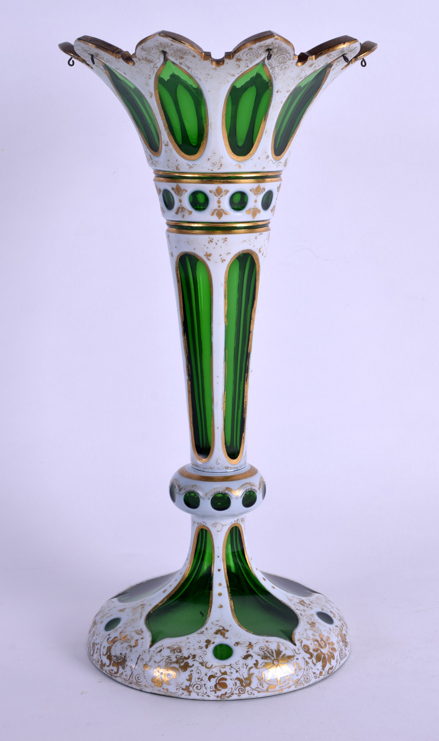 Lot 8 - A LATE 19TH CENTURY BOHEMIAN GREEN AND WHITE OVERLAID GLASS VASE painted in gilt with foliage. 26 cm