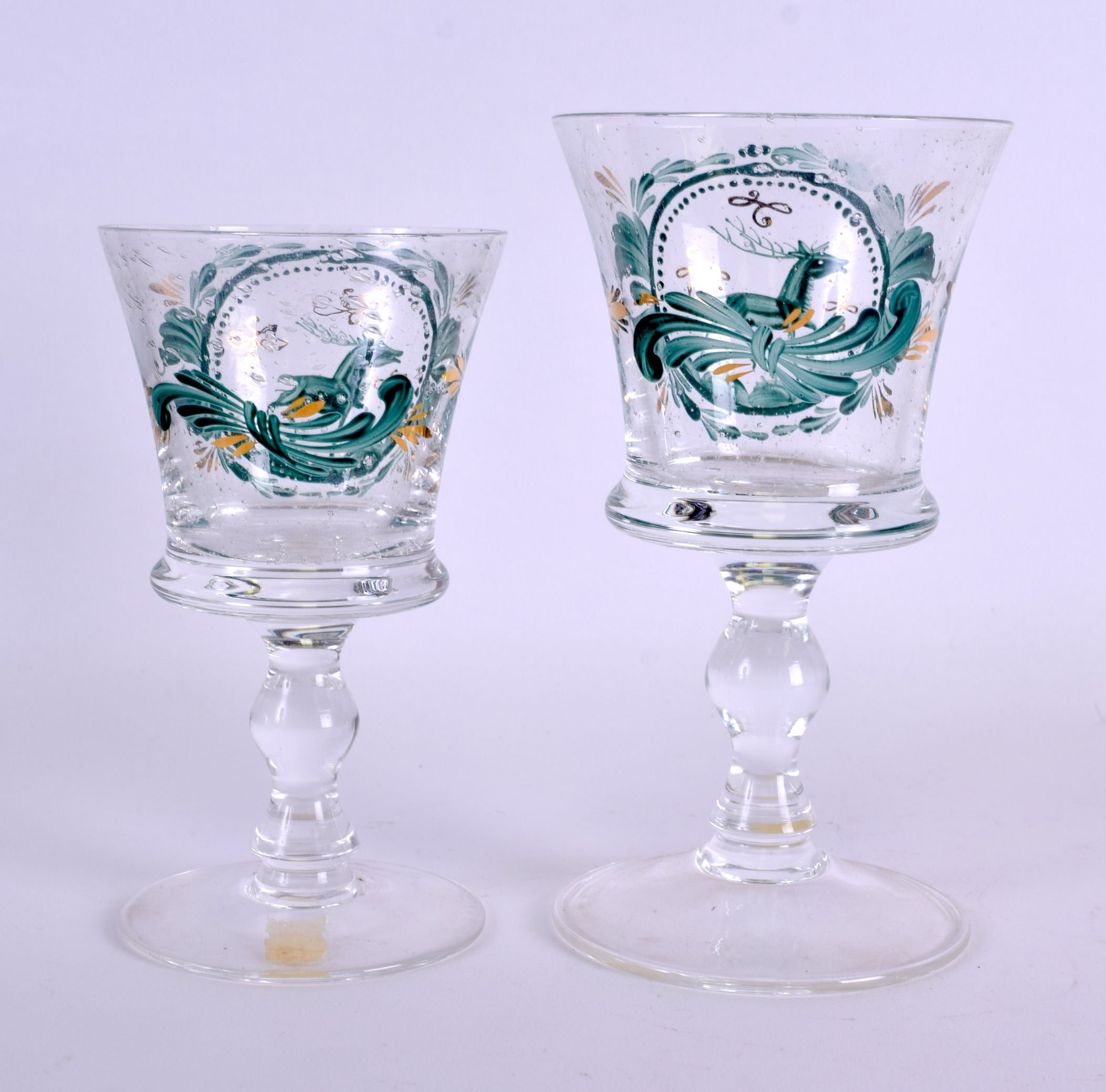 Lot 5 - A 19TH CENTURY GERMAN EAMELLED GLASS CUP together with a matching cup, painted with stags within