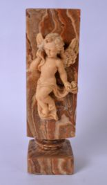 Lot 2409 - A LARGE MARBLED HARDSTONE VASE, decorated with a cherub with one hand by his face. 27.5 cm high.