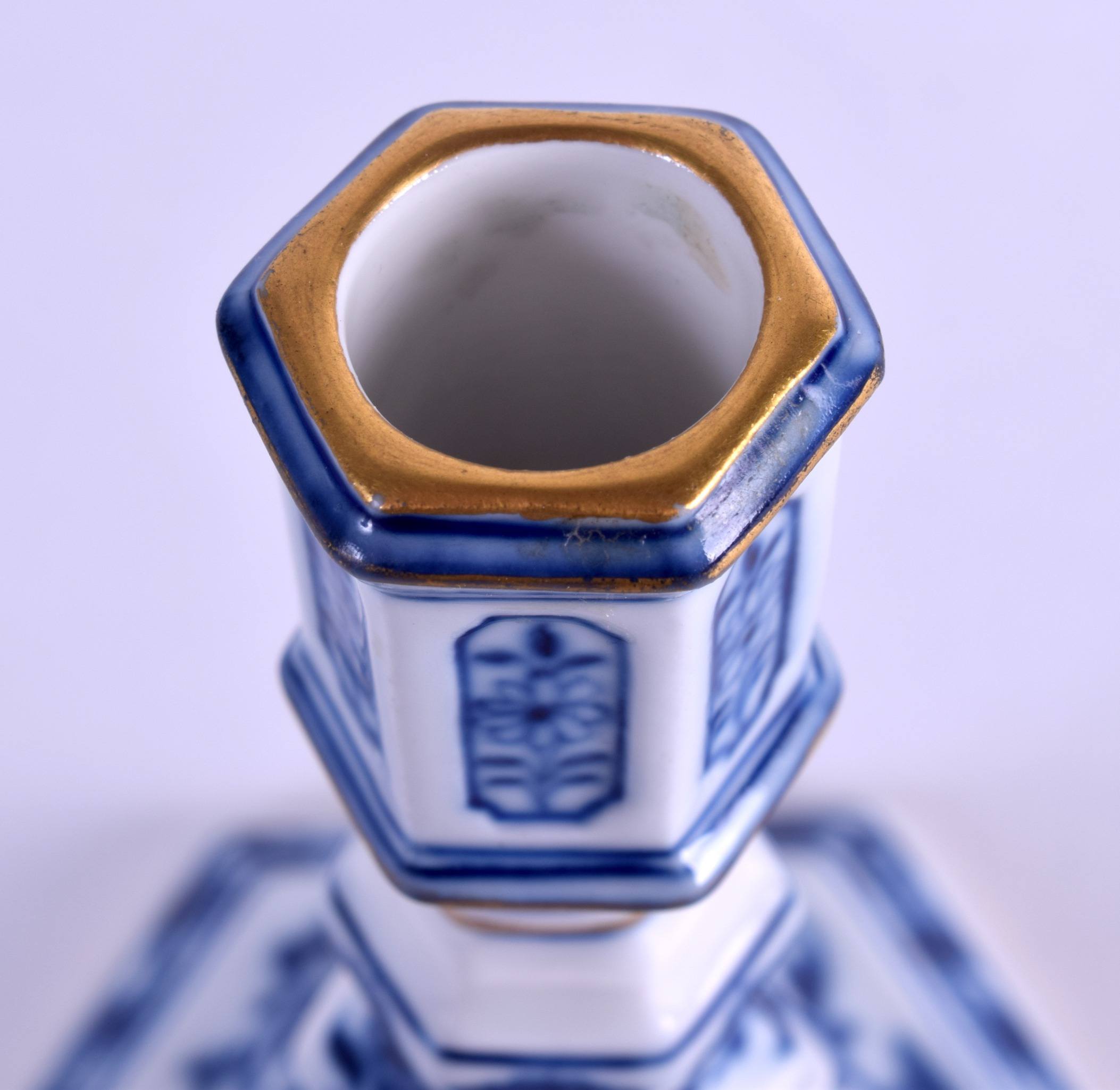 Lot 52 - A 19TH CENTURY MEISSEN BLUE AND WHITE PORCELAIN CANDLESTICK painted with an onion type pattern. 13