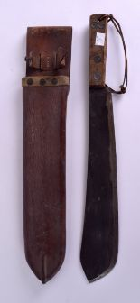 Lot 490 - A WWI MILITARY BUTCHERS KNIFE within original leather case. Knife 51 cm long.