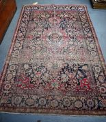 Lot 2928 - A GOOD 19TH CENTURY PERSIAN RED GROUND RUG, decorated wit extensive foliage and motifs. 214 cmx x