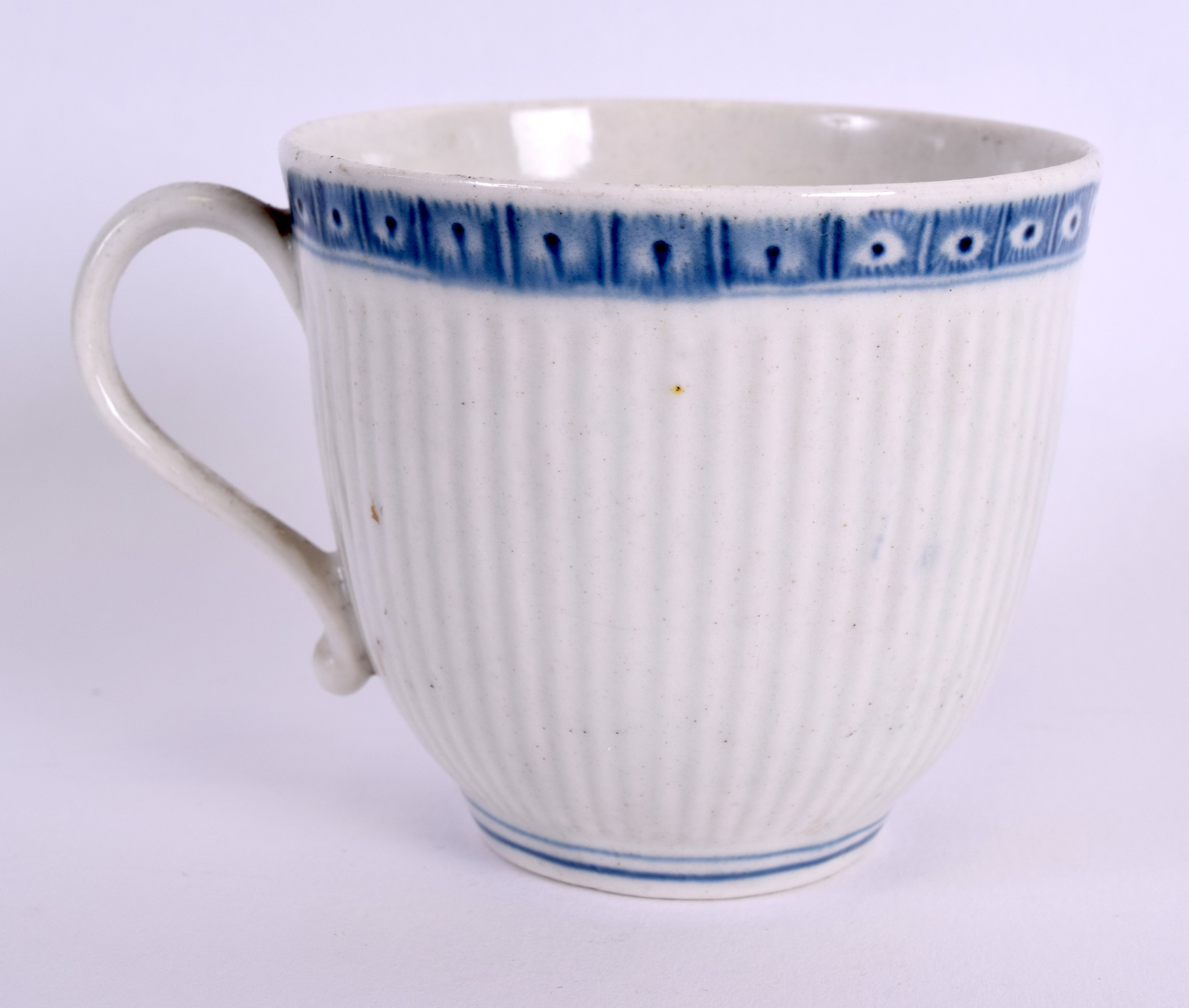 Lot 99 - AN 18TH CENTURY WORCESTER RIBBED COFFEE CUP painted with a single cell border upon a ribbed body.