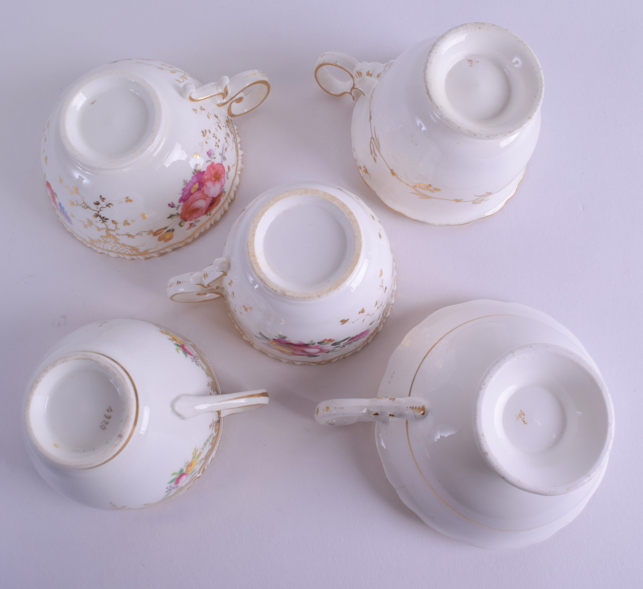 Lot 111 - A GROUP OF THREE EARLY 19TH CENTURY COALPORT CUPS AND SAUCERS together with an antique Adams style