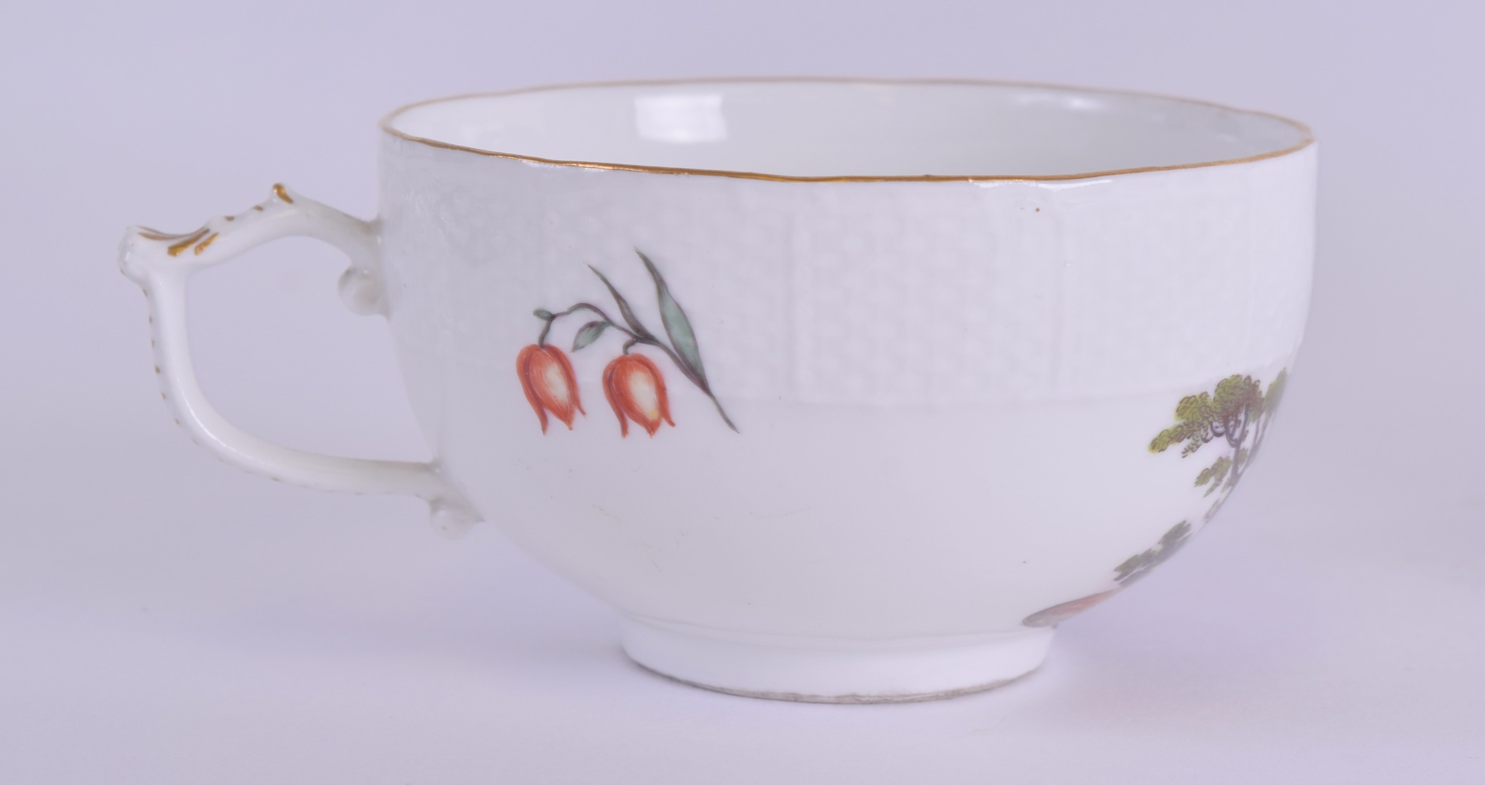 Lot 110 - AN 18TH/19TH CENTURY MEISSEN PORCELAIN TEACUP AND SAUCER painted with figures within landscapes.