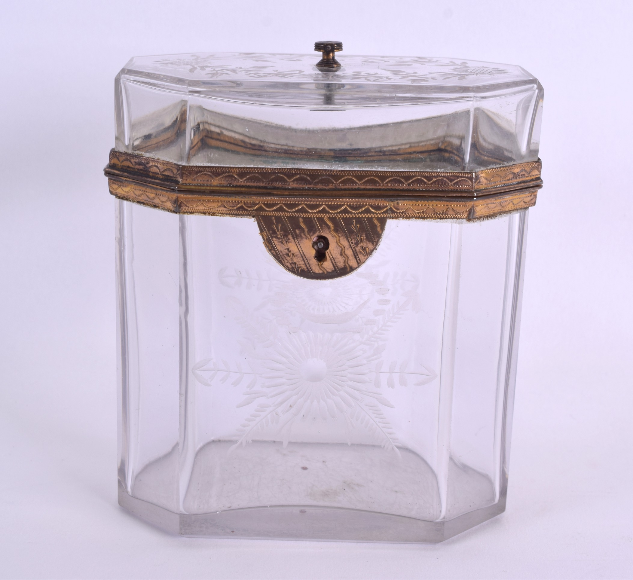 Lot 29 - AN UNUSUAL EARLY 19TH CENTURY CRYSTAL GLASS TEA CADDY engraved with flowers and vines. 12 cm x 10