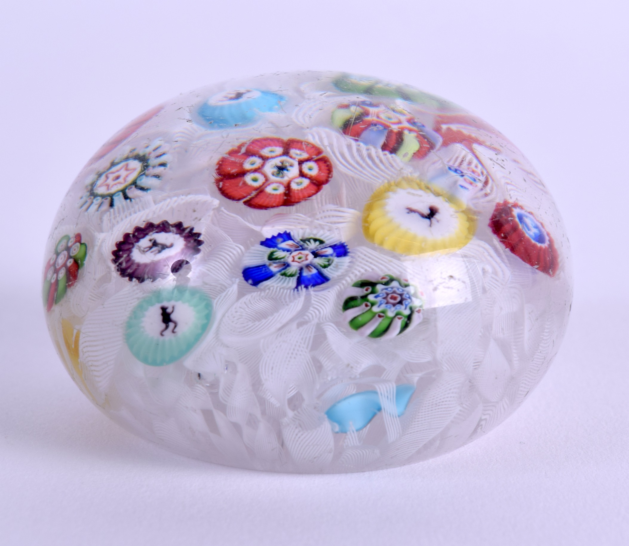 Lot 23 - A 19TH CENTURY FRENCH BACCARAT GLASS SCRAMBLE PAPERWEIGHT dated 1848. 6 cm wide.