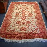 Lot 2929 - A 20TH CENTURY RED GROUND ZIEGLER RUG, decorated with foliage. 190 cm x 140 cm.