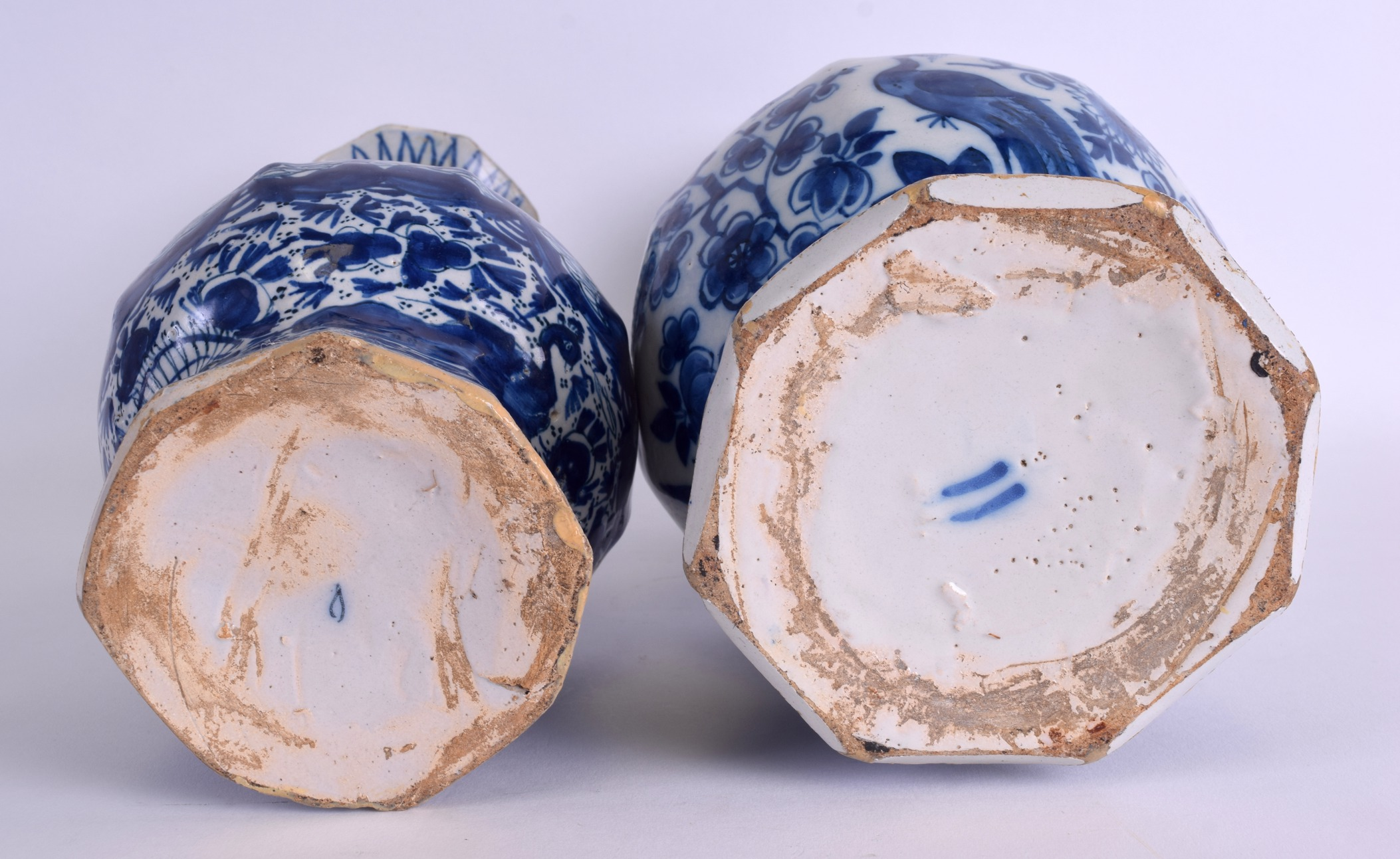 Lot 85 - TWO LARGE 18TH CENTURY DELFT BLUE AND WHITE VASES painted with flowers. 31 cm & 27 cm high. (2)