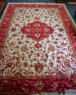 Lot 2931 - A LARGE RED GROUND KESHAN RUG, decorated with foliage. 280 cm x 200 cm.