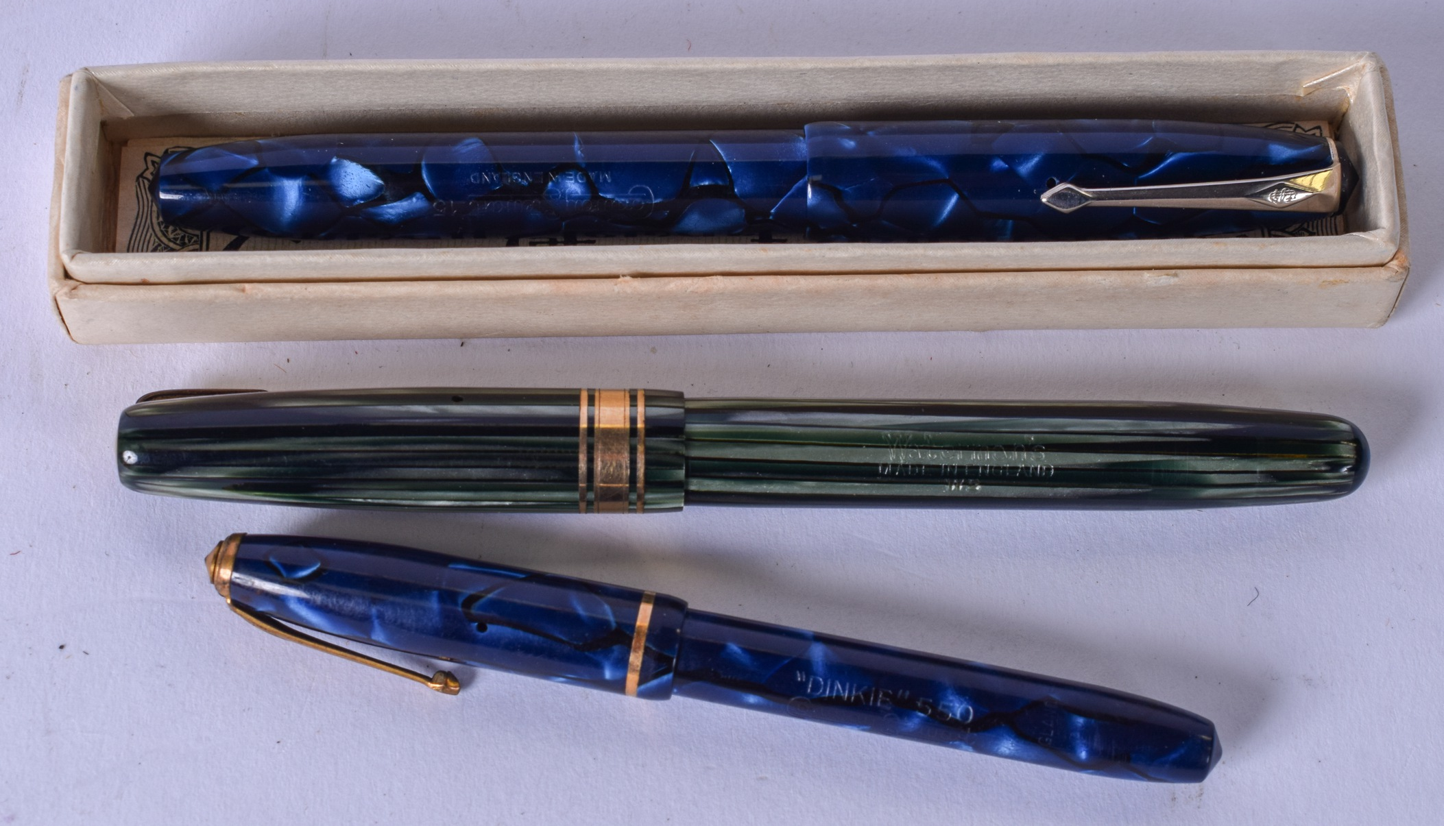 Lot 2787 - THREE GOLD NIB FOUNTAIN PENS, with imitation hardstone design to body.(3)