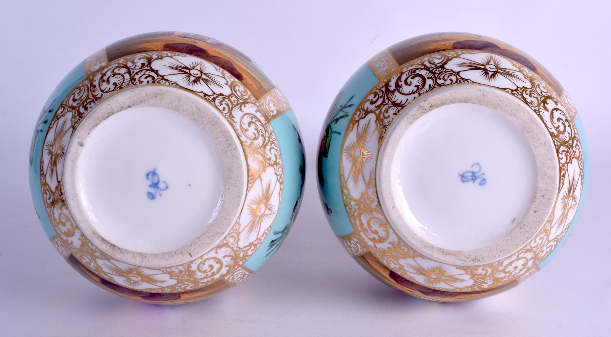 Lot 51 - A LARGE PAIR OF 19TH CENTURY GERMAN AUGUSTUS REX PORCELAIN VASES painted with lovers within