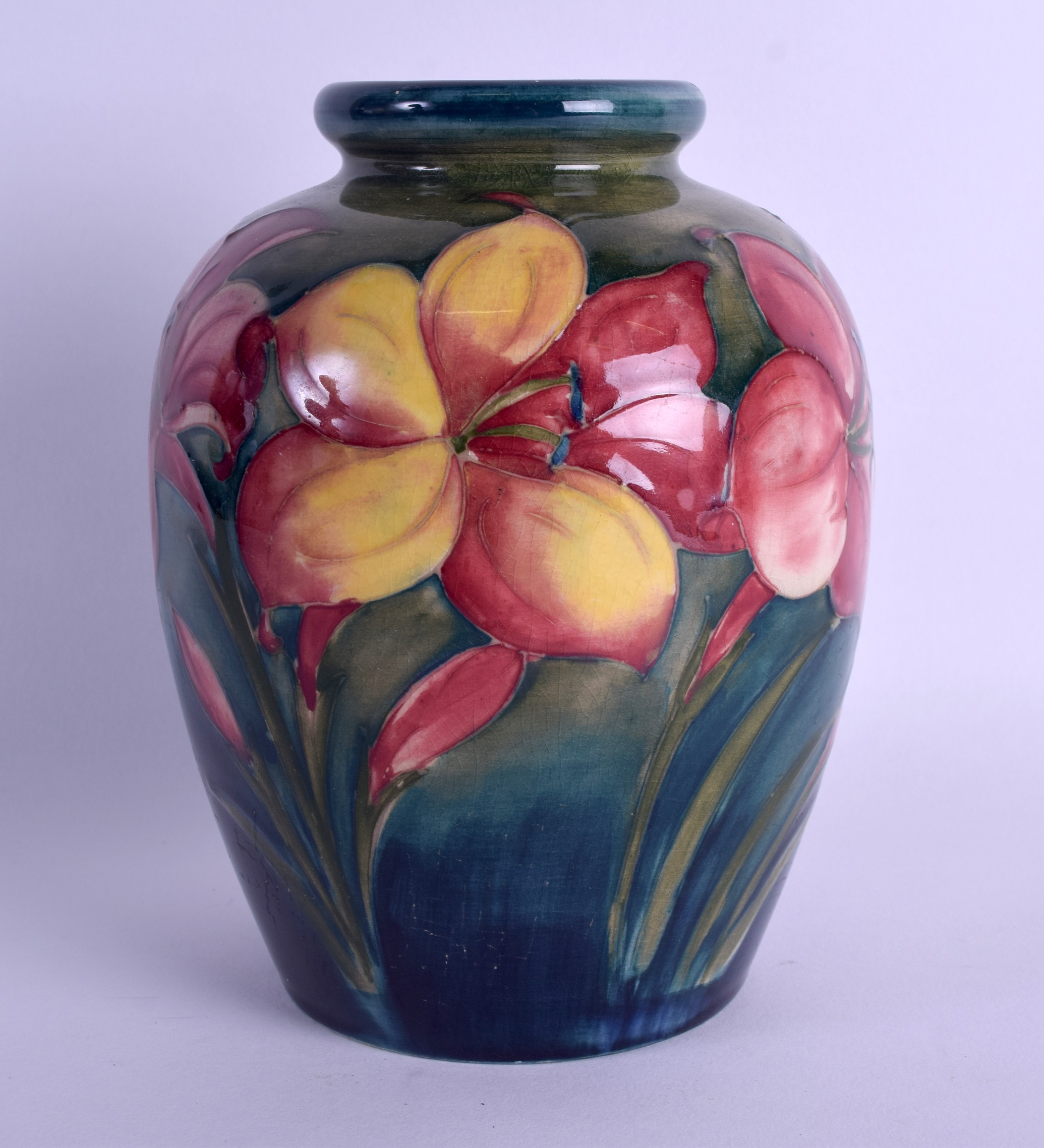 Lot 90 - A WILLIAM MOORCROFT POTTERY VASE painted with floral sprays. 15.5 cm high.