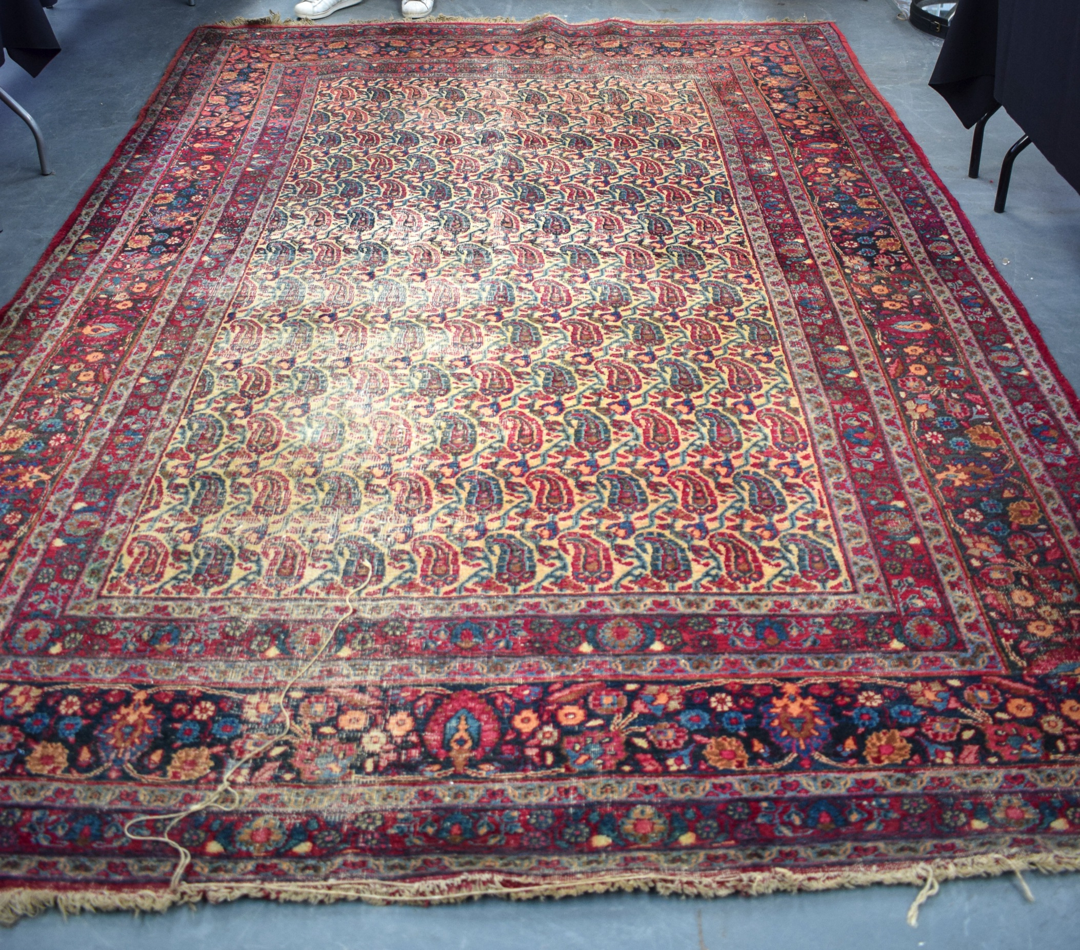 Lot 2481 - AN ANTIQUE EARLY 20TH CENTURY PERSIAN BOTEH RUG, decorated with extensive foliage. 340 cm x 222 cm.