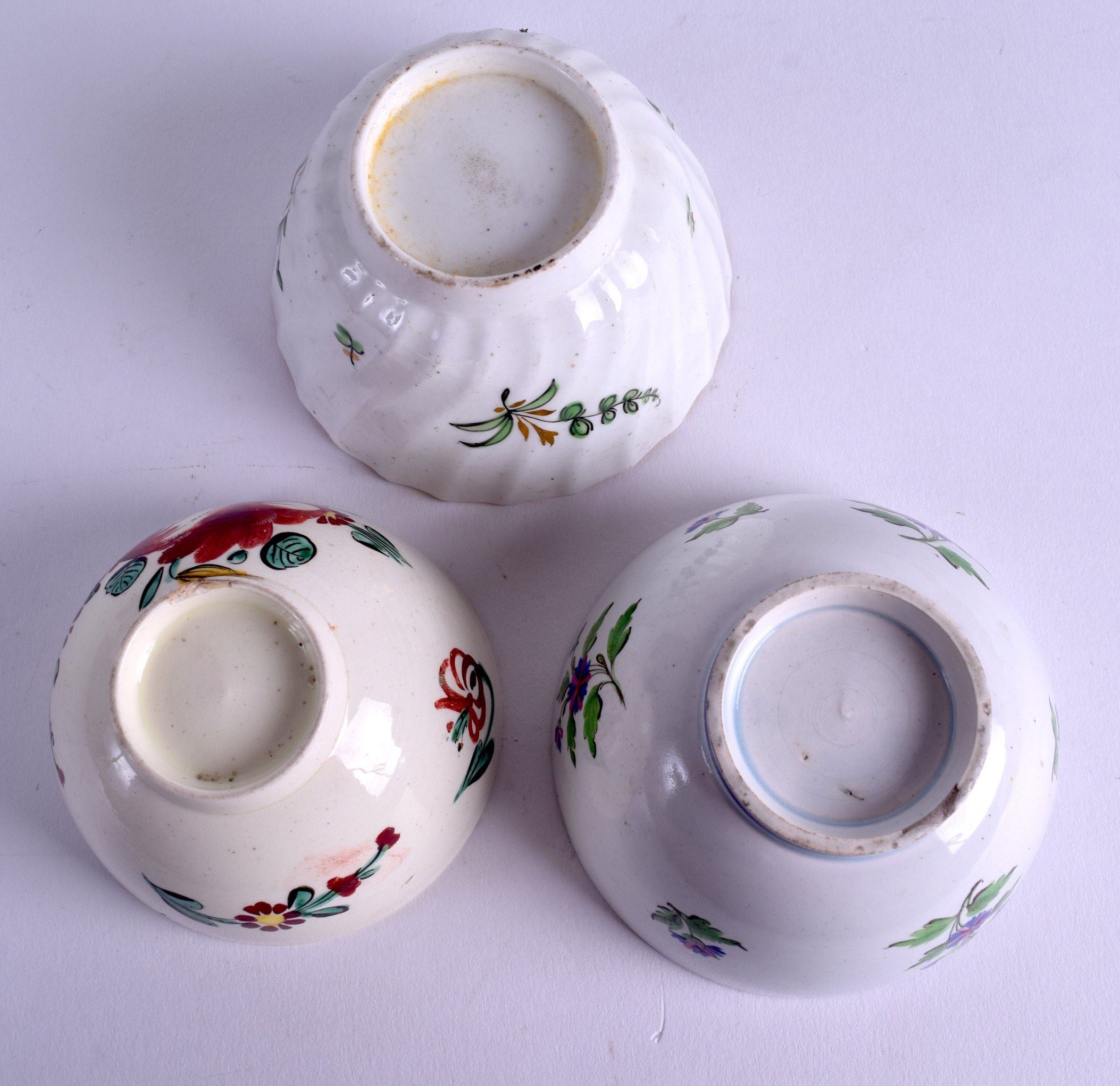 Lot 87 - A LATE 18TH CENTURY LEEDS CREAMWARE TEABOWL painted with flowers, together with two other similar