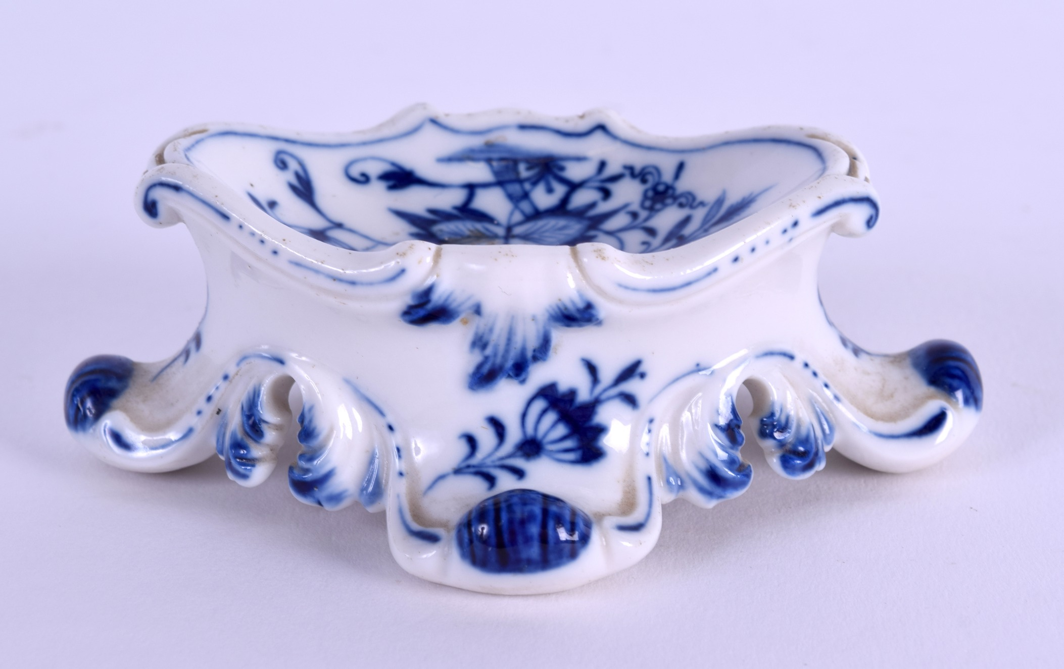 Lot 54 - A 19TH CENTURY MEISSEN BLUE AND WHITE PORCELAIN SALT painted with the onion pattern. 10 cm x 3 cm.