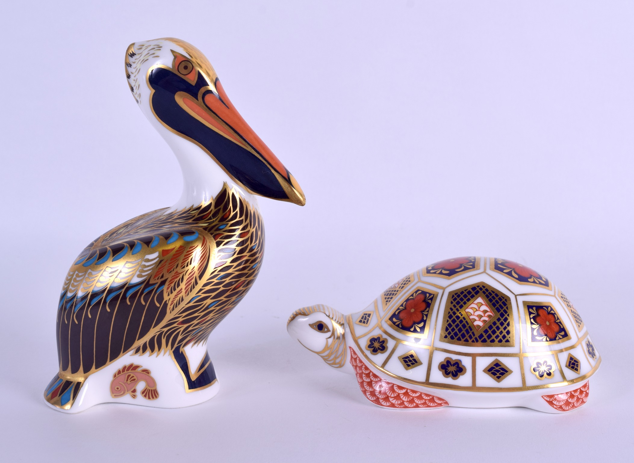 Lot 63 - TWO ROYAL CROWN DERBY IMARI PAPERWEIGHTS in the form of a tortoise & a brown pelican. (2)