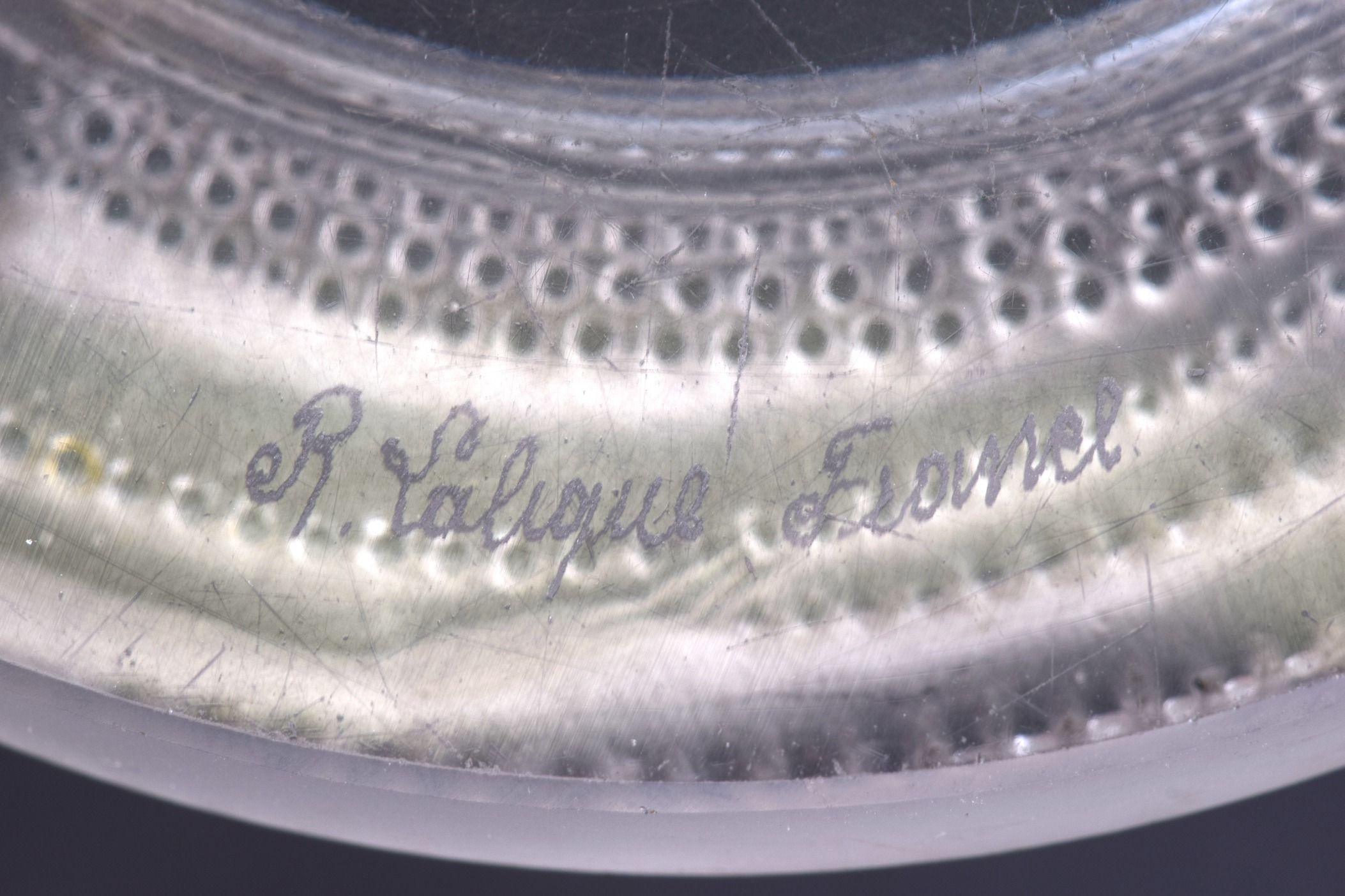 Lot 1 - AN ART DECO FRENCH RENE LALIQUE CIRCULAR DISH in the form of a stylised female with her hand