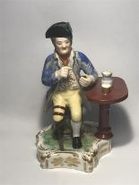 Lot 110 - Derby Figure Of One Legged Gentleman at Table