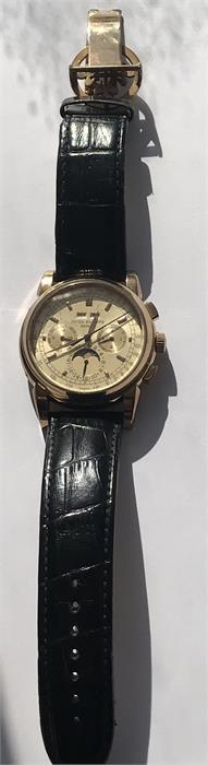 Lot 57 - A replica Patek Philippe Geneve watch - kinetic movement -58152