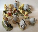"Lot 6 - Sixteen Royal Doulton Winnie the Pooh collection figures Including Pooh and Piglet the windy day"" WP"