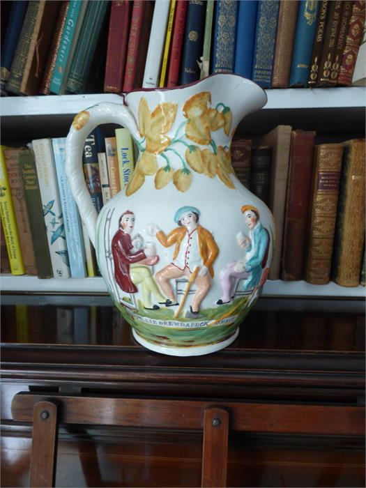 Lot 25 - A Scottish prattware harvest jug