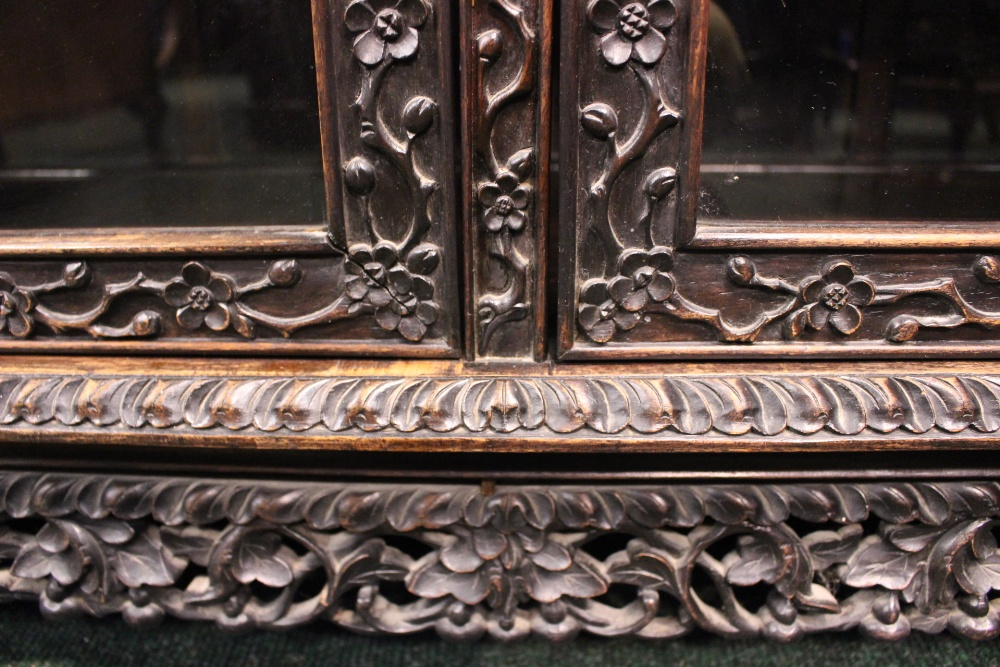Lot 34 - A VERY FINE 19TH CENTURY CHINESE HARDWOOD CARVED DISPLAY CABINET, circa 1835