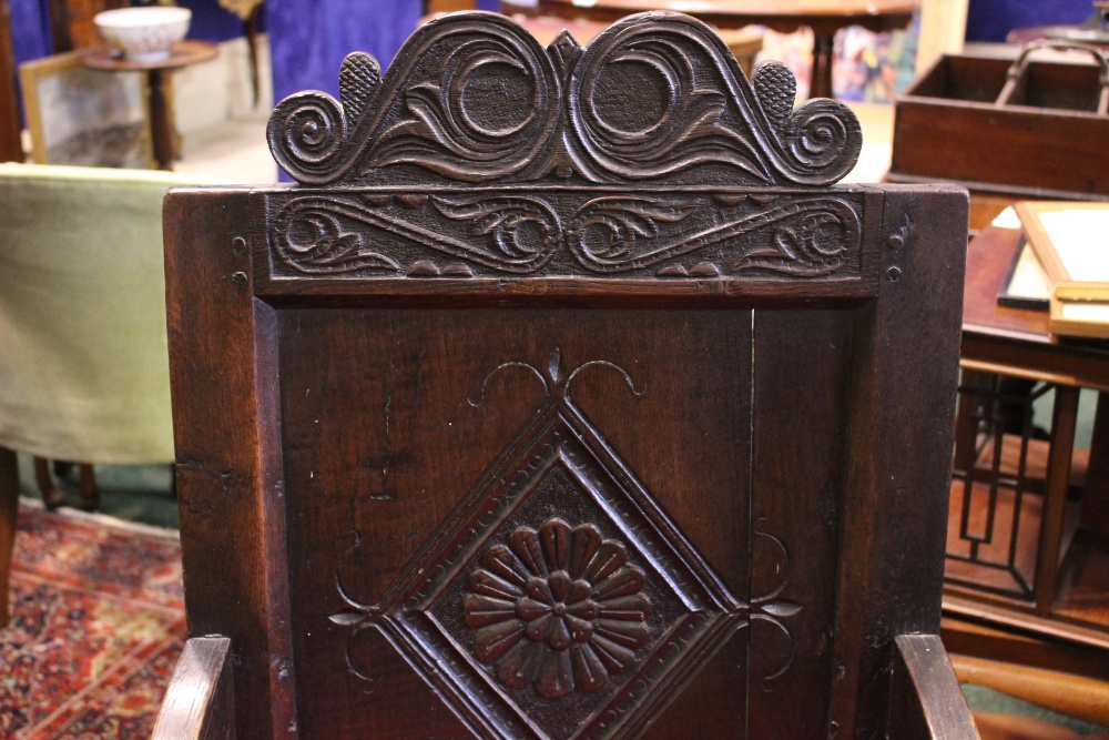 """Lot 46 - AN OAK """"WAINSCOT"""" ARMCHAIR, with square panel back, having carved top rail, and lozenge shaped"""