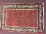 Lot 39 - Rugs: Red ground Iranian rug, stylised birds & flowers, guard borders. 60ins. x 42ins.