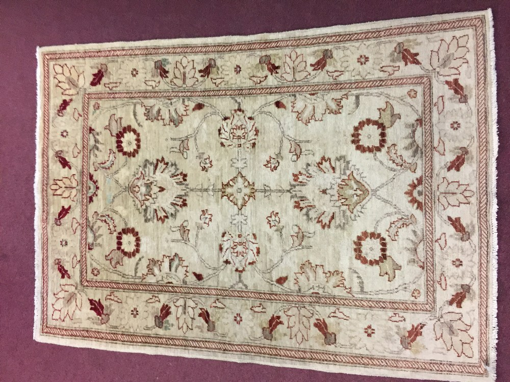 Lot 40 - Carpets: Ivory ground machine woven rug with 2 borders and red floral motifs. 66ins. x 50ins.