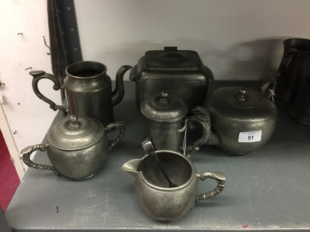 Lot 51 - 19th cent. Chinese Export: Kut Hing Swatow pewter, large teapot with lid and strainer, small two