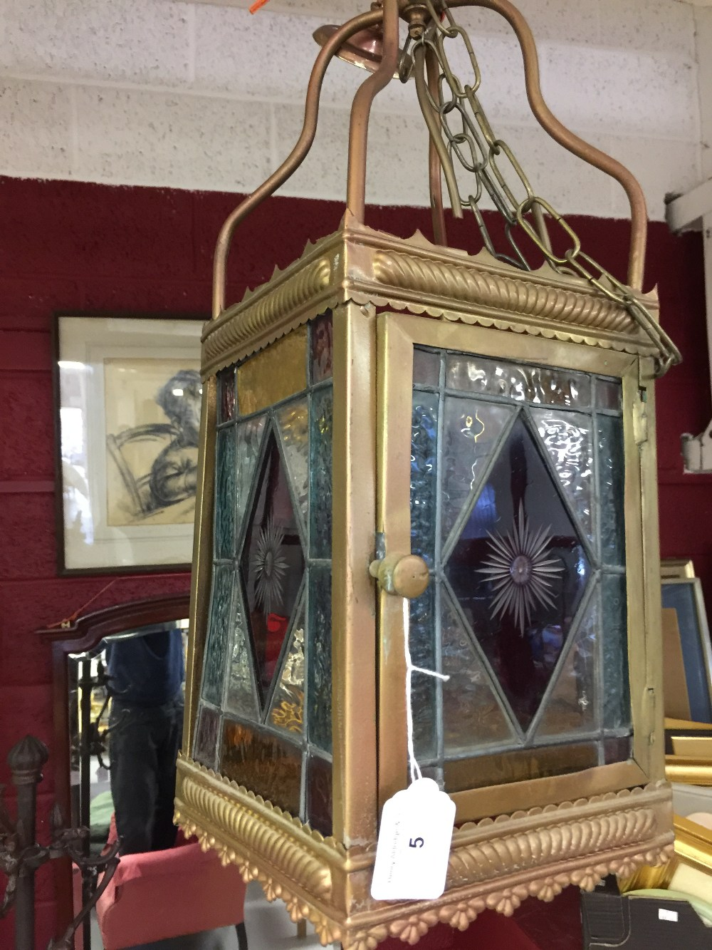 Lot 5 - 20th cent. Lighting: Gothic style brass hall lantern with stained glass panels. 22ins. rectangular