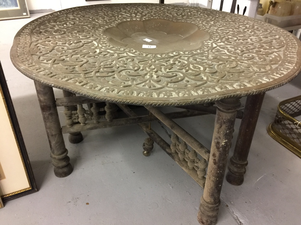 Lot 17 - 19th cent. Islamic brass folding table with large brass top.