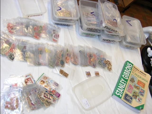 Lot 7 - Eleven plastic containers with collectable stamps