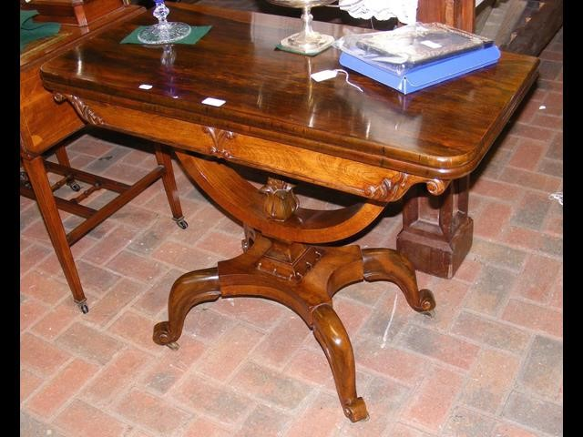 Lot 57 - William IV rosewood fold-over games table with shaped un