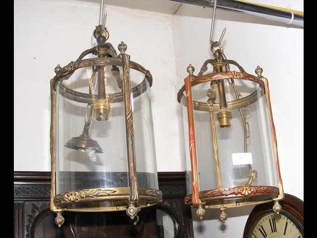 Lot 50 - A pair of decorative glass and brass porch lamps