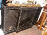 Lot 46 - Carved Victorian oak break-front bookcase