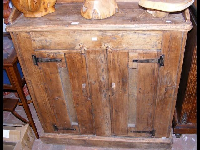 Lot 24 - An old pine two door cupboard