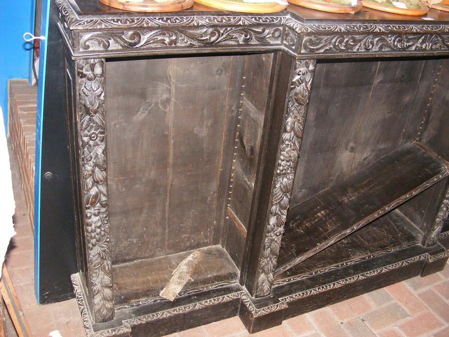 Lot 46 - Carved Victorian oak break-front bookcase