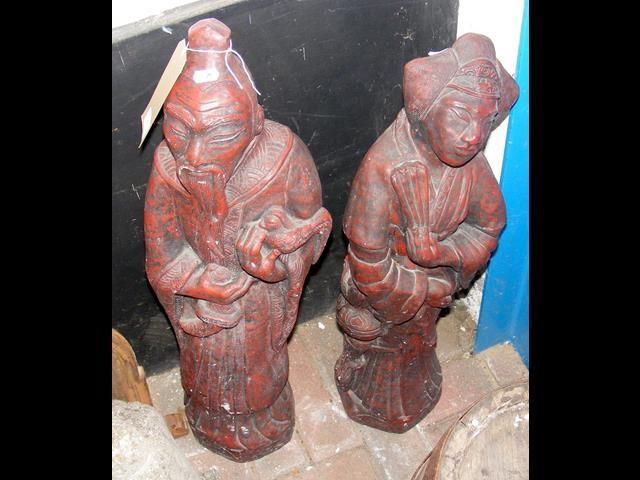 Lot 2 - A pair of 82cm high red oriental garden statues