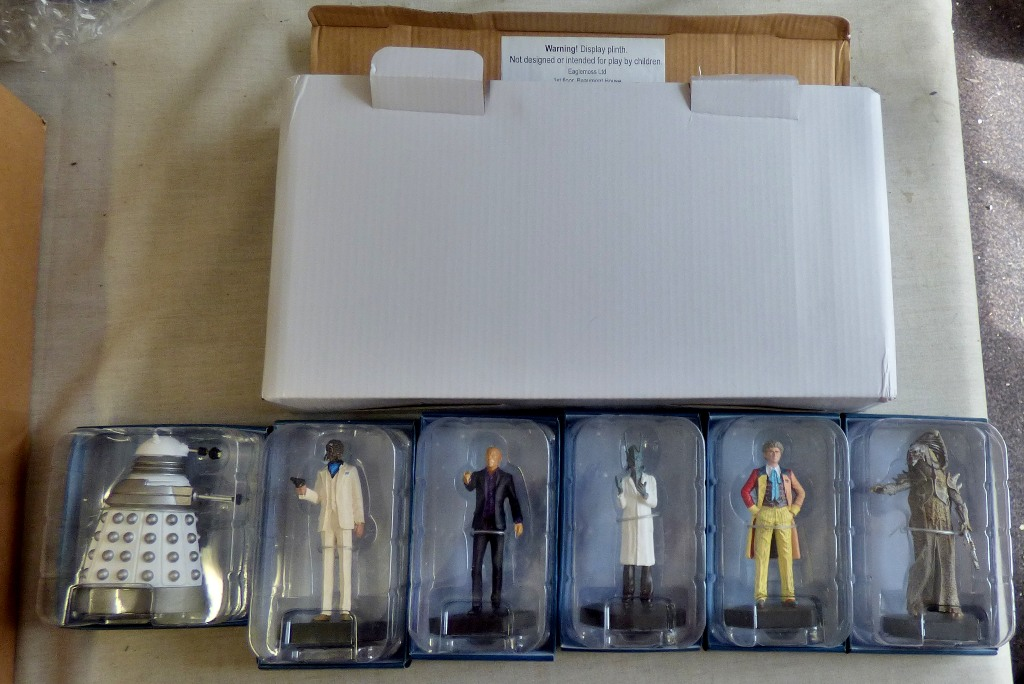 Lot 10 - Dr Who-(6) Figures + Plinth and magazines and folder-Models-The Fisher King ADV0693-The Sixth Doctor