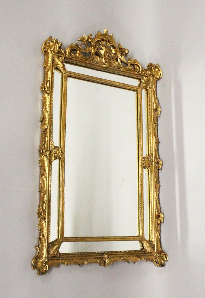 Lot 1016 - A CARVED GILTWOOD PIER MIRROR. 3ft 0ins high x 1ft 10ins wide.
