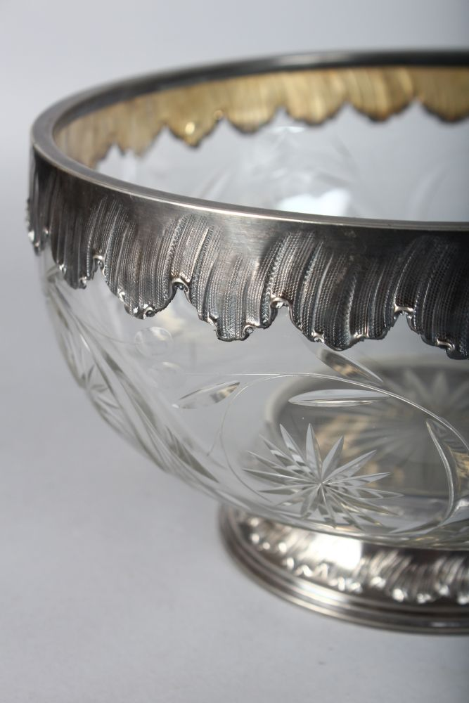 Lot 1060 - A GOOD CUT CRYSTAL FRUIT BOWL with silver rim and base. 8.5ins diameter.