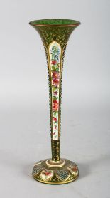 Lot 1040 - A TALL BOHEMIAN TAPERING GREEN GLASS TRUMPET VASE, with white enamel decoration and flowers. 12ins