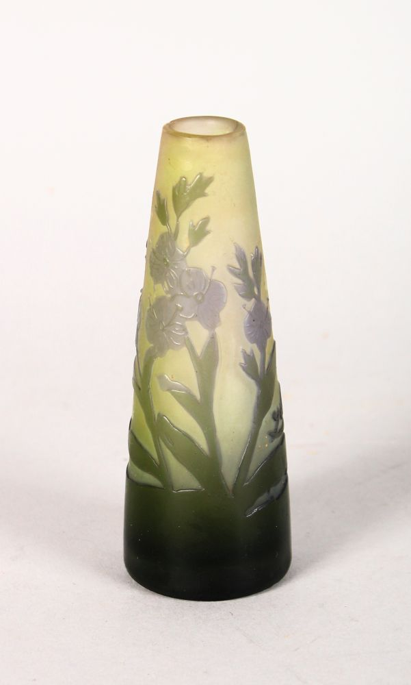 Lot 1041 - A SMALL GALLE TAPERING CAMEO GLASS VASE with flowers and leaves. Signed in cameo. 4ins high.