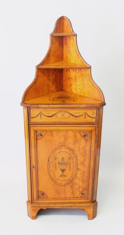 Lot 1006 - A SATINWOOD INLAID MARQUETRY LOW CORNER CABINET, LATE 19TH CENTURY, with floral marquetry