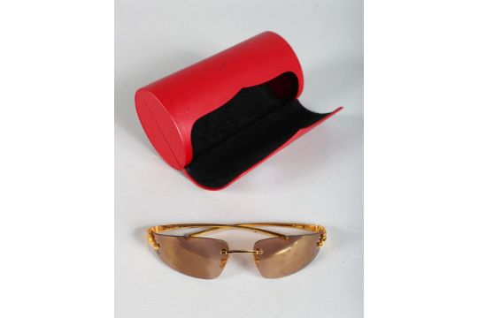 83b7987fea3 A PAIR OF CARTIER GOLD METAL PANTHER SUNGLASSES