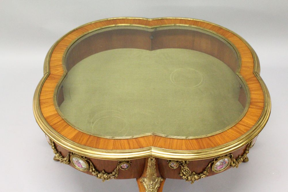 Lot 1018 - A GOOD FRENCH, KINGWOOD AND ORMOLU LOW VITRINE TABLE, 20TH CENTURY, of quatrefoil outline, the