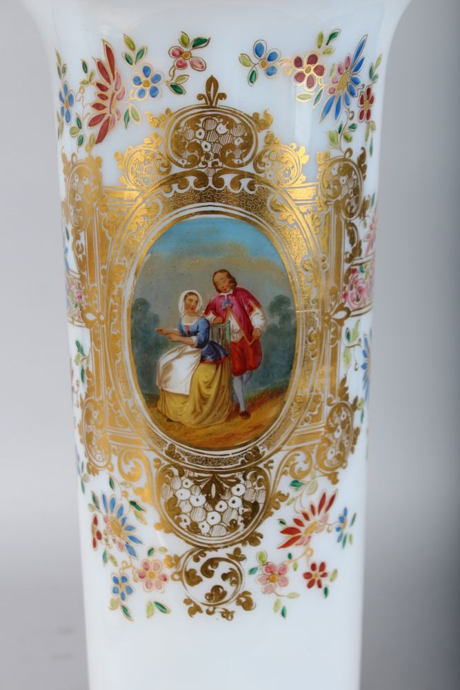 Lot 1038 - A VERY GOOD LARGE PAIR OF FRENCH MILK GLASS VASES, with gilt decoration and painted with ovals of