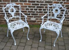 2 cast alloy patio chairs